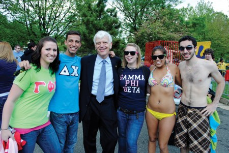 George Mason University President Alan Merten poses with members of the Gamma Phi Beta and Delta Chi Greek organizations.