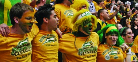 Students cheer on the Patriots at last year's Homecoming basketball game.